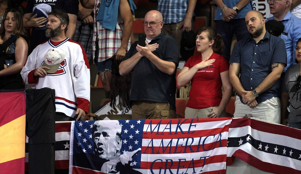 'Mass delusion': Why Trump's followers believe their leader has given their lives meaning