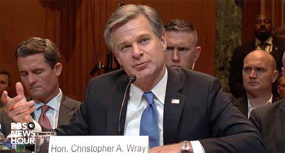 FBI director Chris Wray pushes back on Bill Barr's claim about 'spying' on the Trump campaign