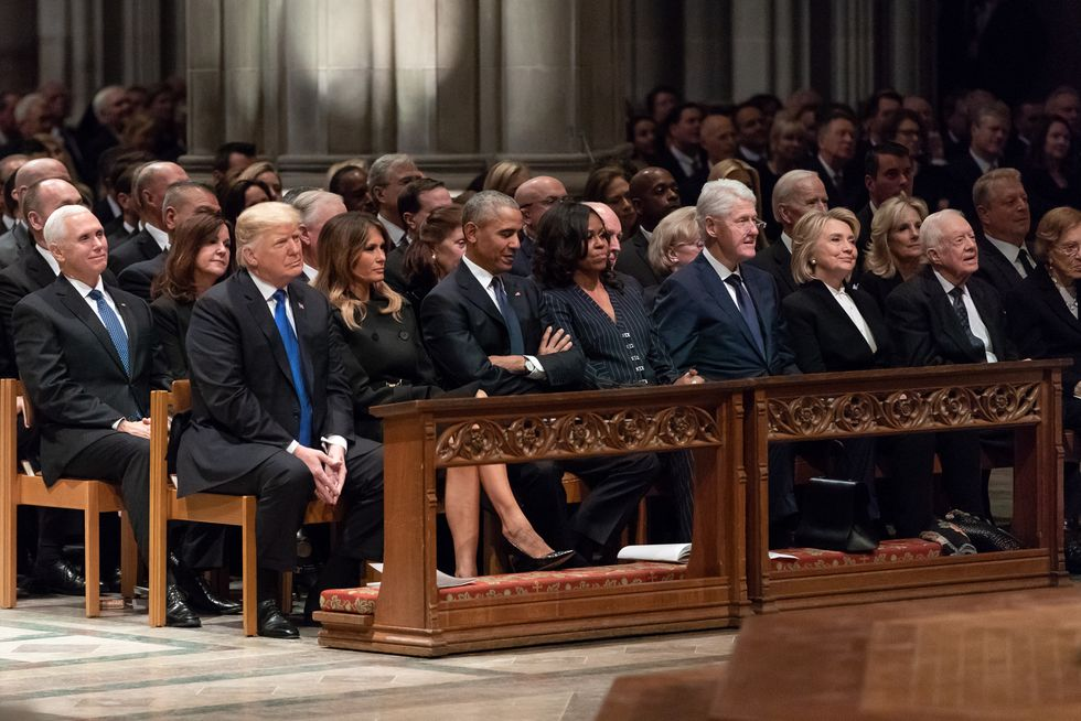 Trump fumed about sharing the spotlight with Bush Sr.  -  but was proud of his behavior at funeral: report