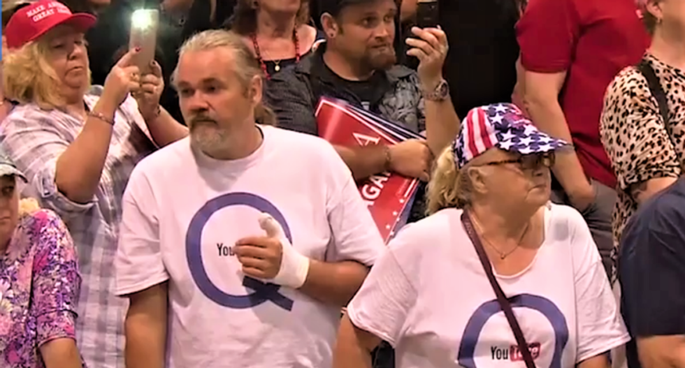 QAnon conspiracists appear at Trump rally — only hours after FBI warning on far-right conspiracy group