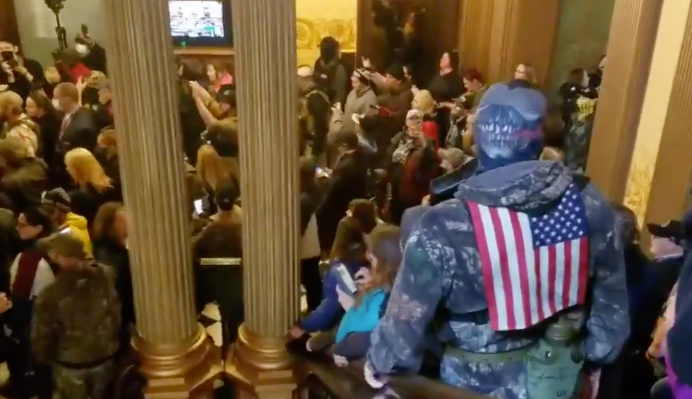 'America in the age of Trump': Armed gunmen enter Michigan Capitol demanding end to lockdown