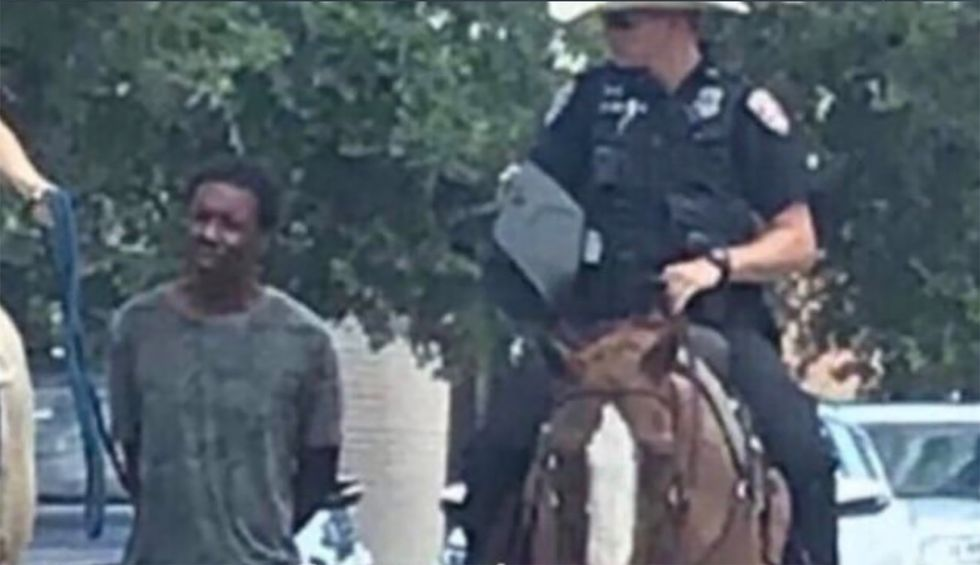 Texas police chief apologizes after white mounted officers lead a black man by rope