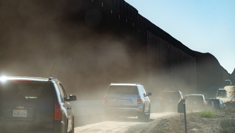 Trump bragged his wall couldn't be knocked down. A long section just got blown over by the wind
