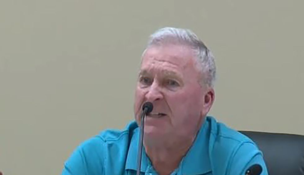 County commissioner uses anti-gay slur and racism to attack Democratic presidential candidate — and the audience applauds