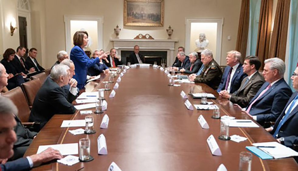 Body language expert dissects the power dynamic at play in the iconic Nancy Pelosi photo