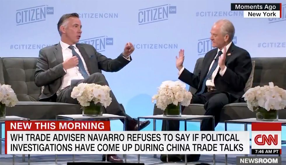 'I am asking you a direct question': CNN reporter corners evasive White House adviser on Trump trade talks