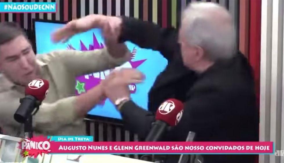 Watch: Glenn Greenwald assaulted by pro-Bolsonaro journalist during live broadcast