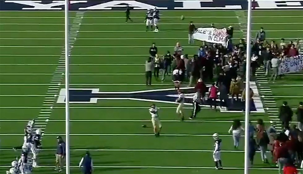 'OK boomer': Hundreds of activists delay Harvard-Yale football game for climate protest