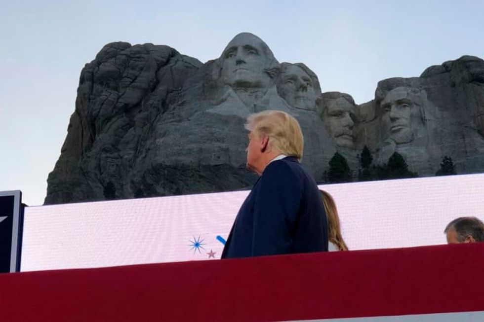 Trump pushes racial division and flouts virus rules at Mount Rushmore