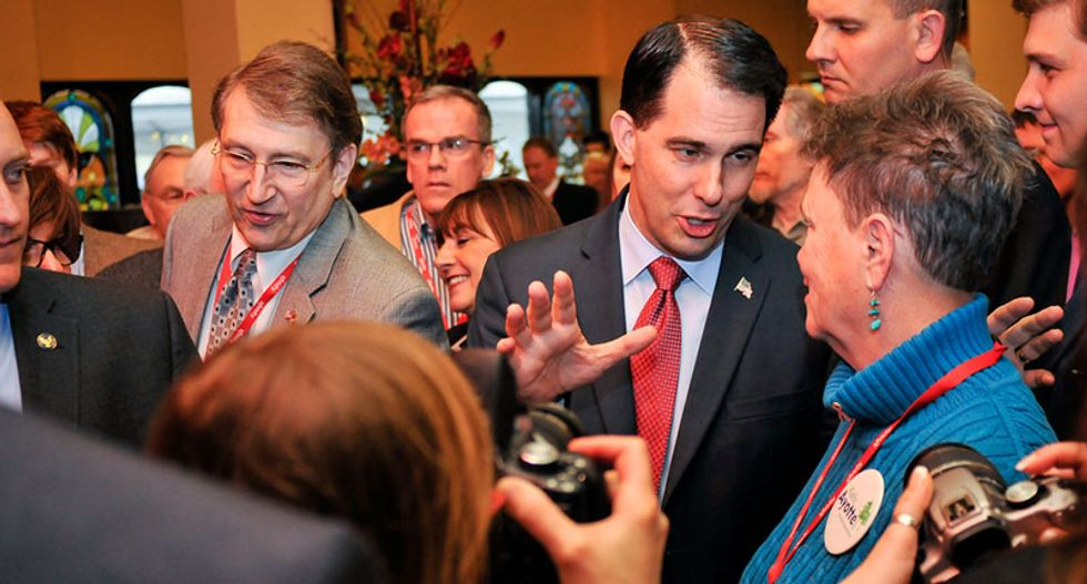 Judge strikes down Scott Walker's vote-suppression measure — but Republicans vow to fight on at taxpayers' expense