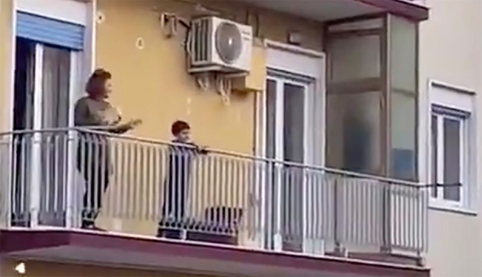 'Triumph of spirit': Locked down Italians sing from balconies — and inspire hope across the world