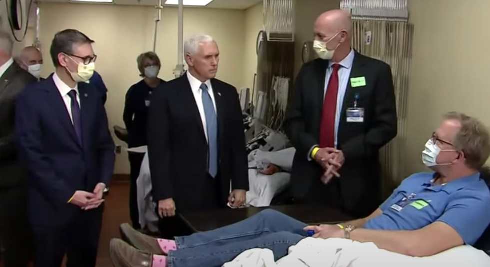 Mike Pence's refusal to wear a mask in a COVID ward was a display of cowardice, not courage
