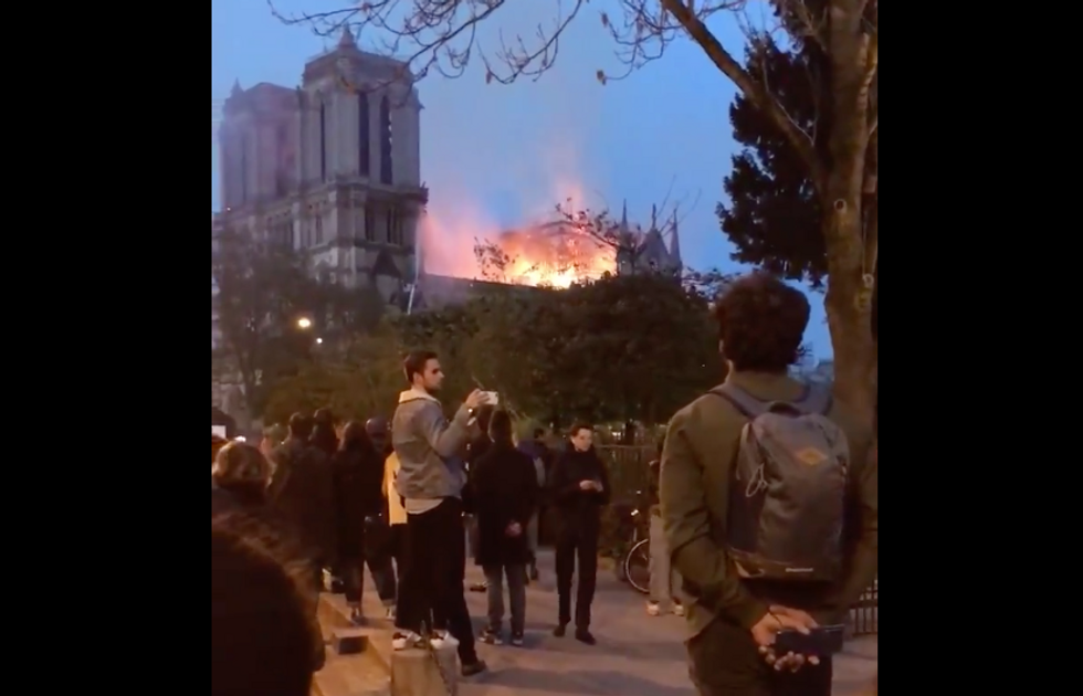 Watch: Parisians sing a haunting song as they see Notre Dame burn