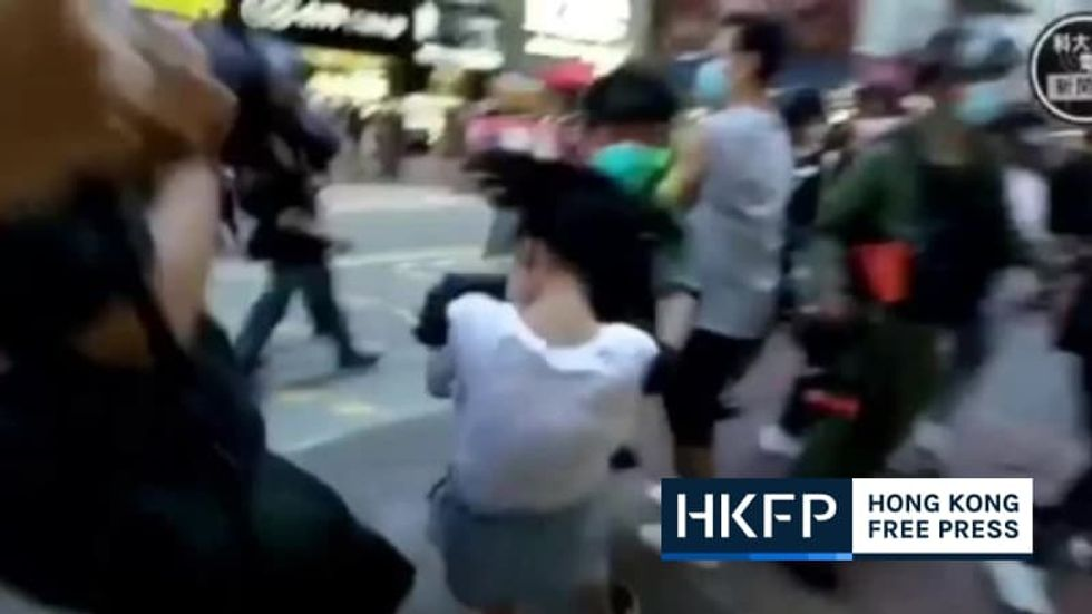 Video: Hong Kong police say 'minimum force' was used to tackle fleeing 12-year-old girl during pro-democracy demo