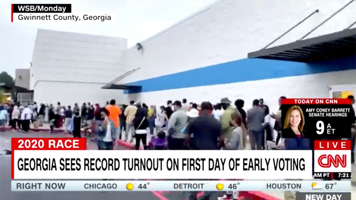 'A picture of voter suppression': Hours-long lines plague first day of early voting in Georgia