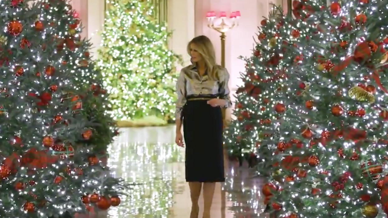 Melania 'delighted' to mark holidays after being caught on tape asking who cares 'about Christmas stuff?'