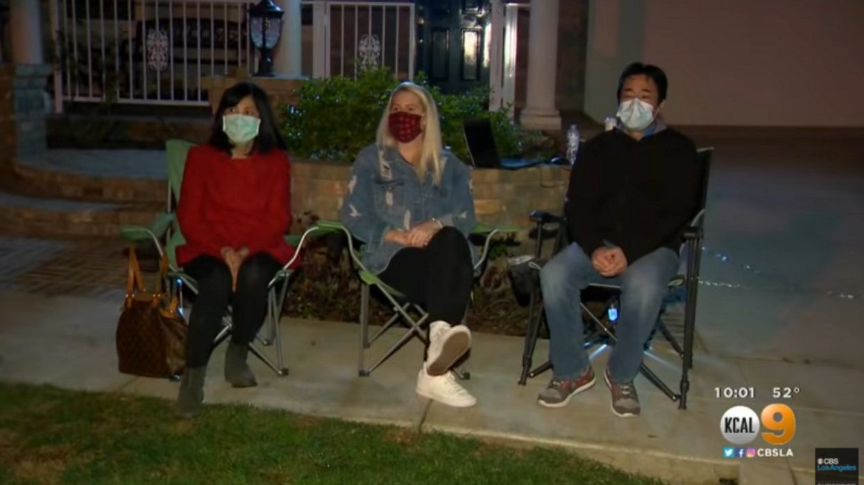 Neighbors stand guard at Asian-American family's home after they were harassed by racist extremists