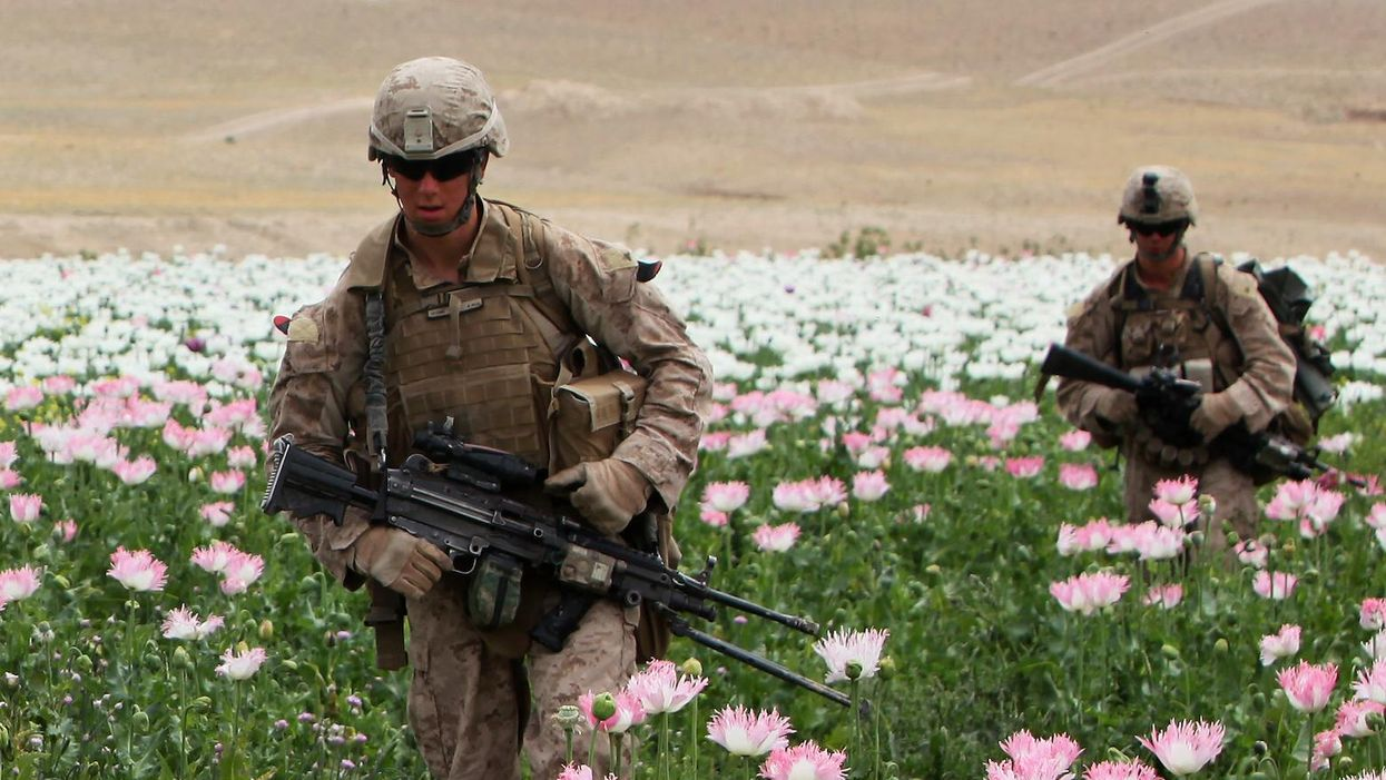 Marines with 2nd Battalion, 5th Marine Regiment, patrol through Musa Qaleh District, Afghanistan, April 17, 2012. During Operation Lariat, Marines engaged in multiple firefights with insurgents before searching suspicious compounds.