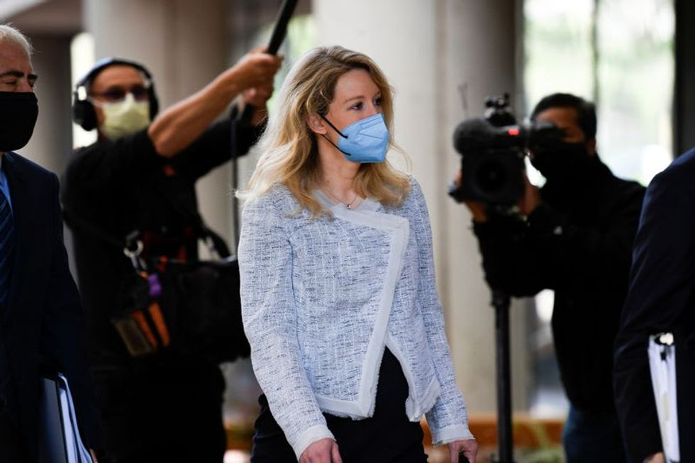 Theranos founder claims abuse by ex-boyfriend in fraud trial