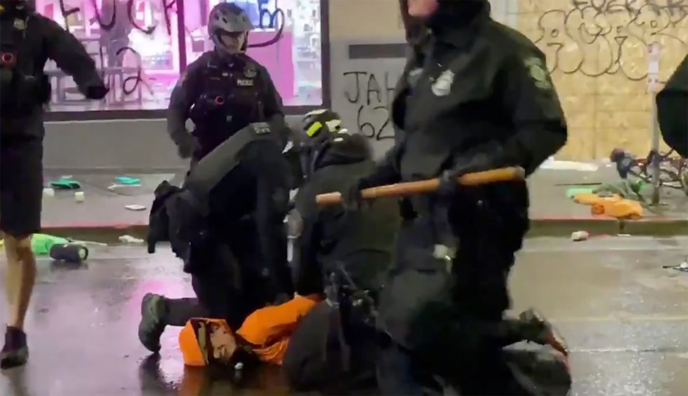 Video shows Seattle cop with knee on neck of George Floyd protestor