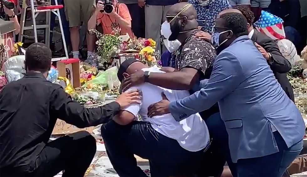 Watch: Emotional moment of silence as George Floyd's brother prays over his Minneapolis memorial