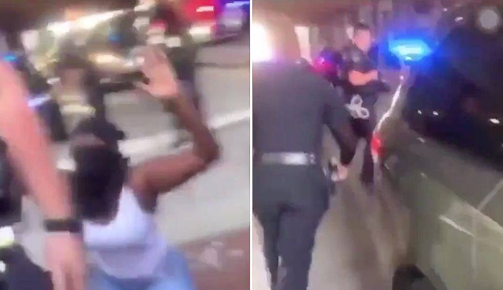 A black female officer chastised her colleague for shoving a kneeling protestor. He's now been removed from duty