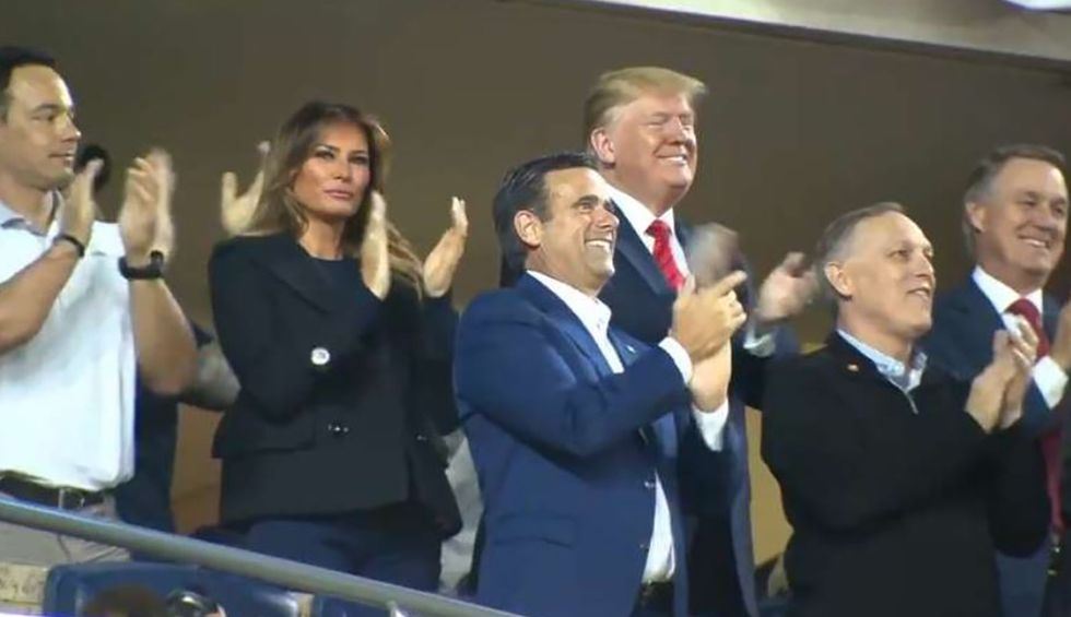 Watch Trump's face change once he realizes World Series ballpark crowd is chanting 'lock him up'