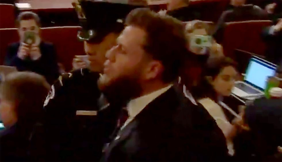 Internet mocks InfoWars protestor who interrupted impeachment hearing to scream 'Trump is innocent!'