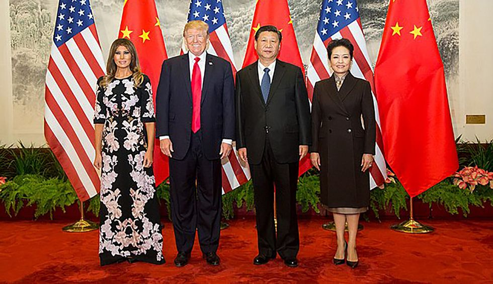 'Celebrating a country that shoots protesters': Trump scorched for congratulating China on adoption of communism