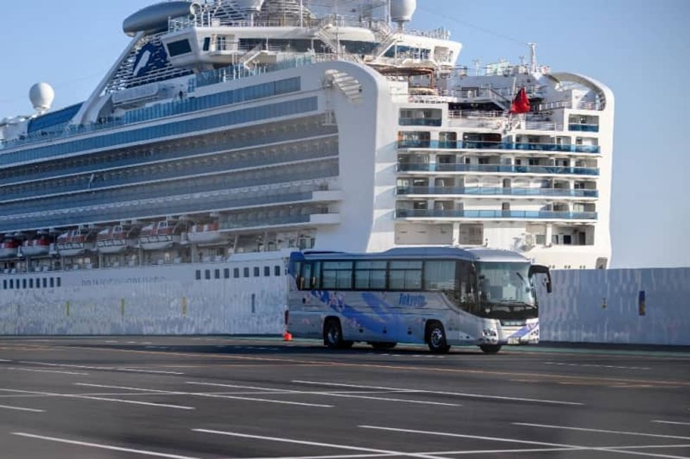 Third death from Japan cruise ship as new cases raise quarantine doubts
