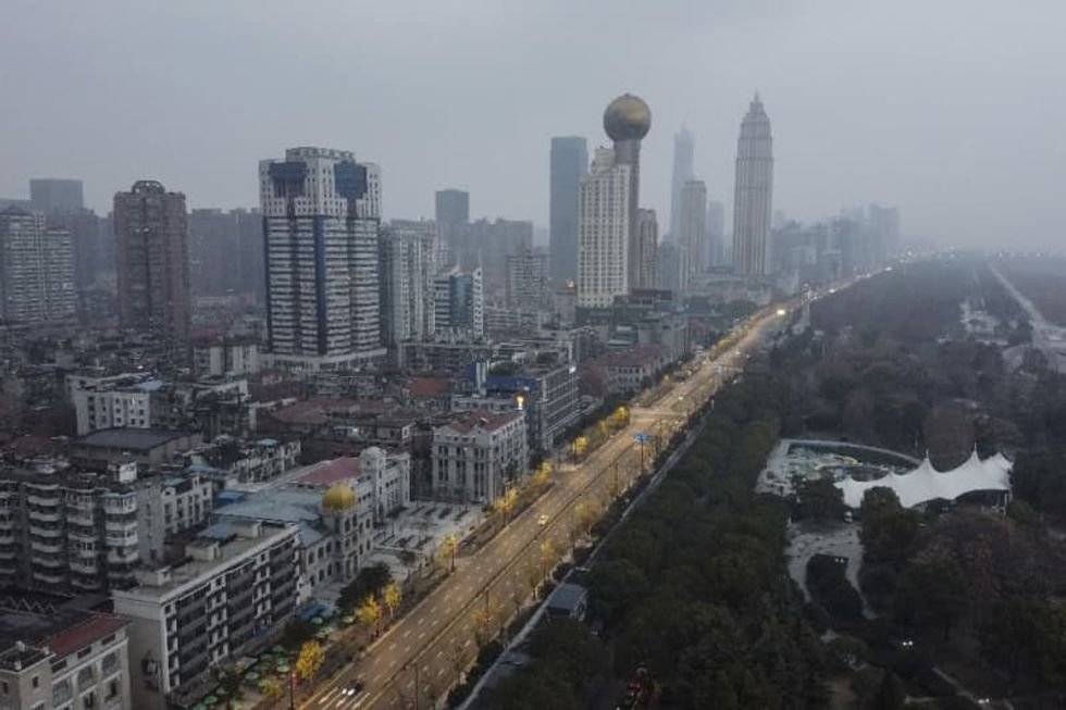 Expelled WSJ China journalist stuck in virus epicentre