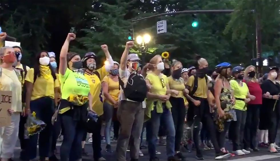 Police goons are tear-gassing sunflower-wielding moms as they defend Portland BLM protestors