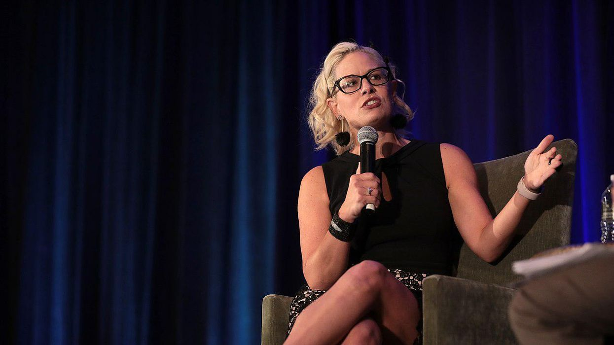 Progressives slam Kyrsten Sinema for infrastructure package 'watered down' by Exxon lobbying influence
