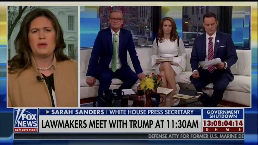 Sarah Sanders loses it on Fox News and dares Pelosi to tear down walls outside people's homes