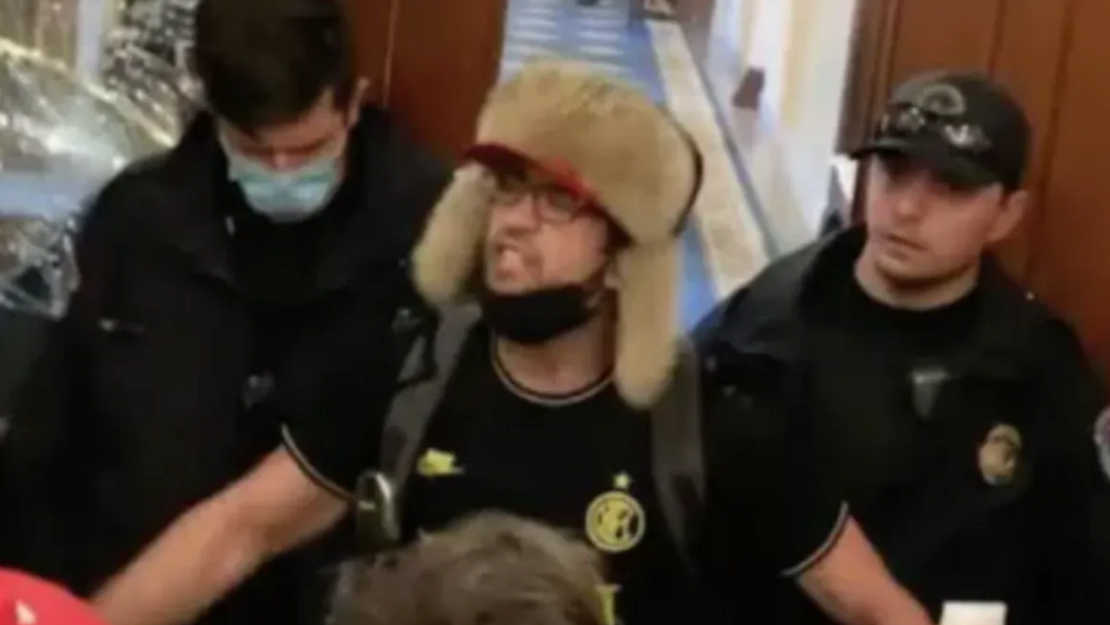 Court hearing devolves into a 'mess' as 'Helmet boy' Capitol rioter rejects plea deal and declares himself 'general counsel'